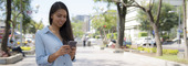 Young Woman Using iPhone 6 In Urban Environment