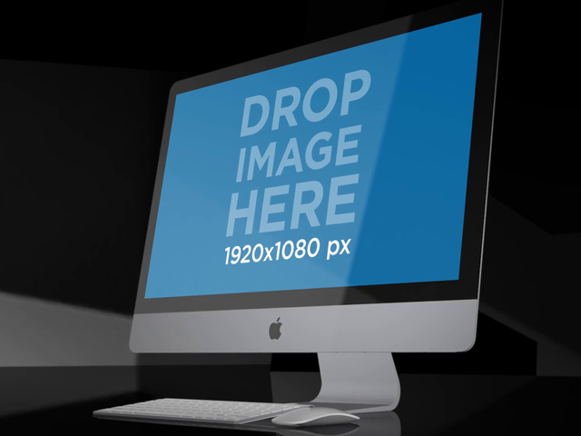 iMac Standing on a Dark Surface Video Mockup a15964