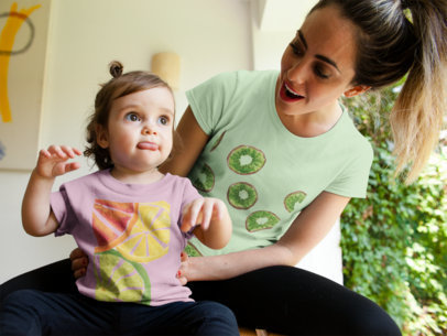Mom and her Little Girl Wearing Different Tshirts Mockup While Talking a16084