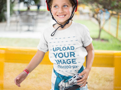 Smiling Girl Wearing a T-Shirt Mockup While Wearing a Red Helmet a16163
