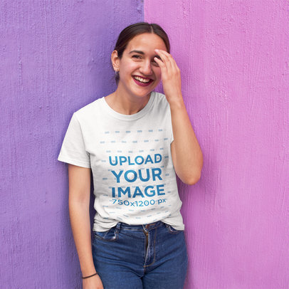 Hispanic Girl Wearing a T-Shirt Mockup While Smiling Against a Two Shades Purple Wall a16230