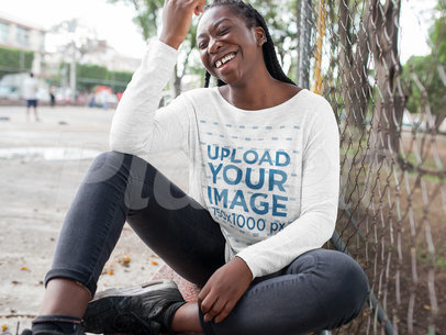 Black Girl with Dreadlocks Wearing a Bella Flowie Long Sleeve Off Neck Tee Template While Laughing in an Urban Area a16200