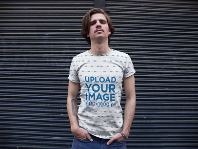 Dude Wearing a Sublimated Round Neck Tee Template While Looking Down on the Camera a15366