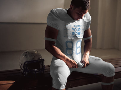 Football Jersey Generator - Man Looking at his Jersey in Locker Room a15937