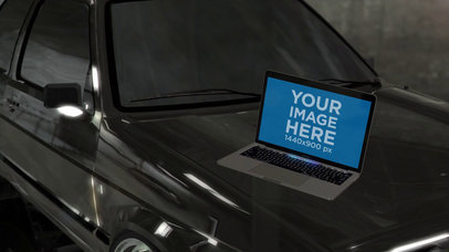 MacBook Pro Video Lying on a Car Hood a16257