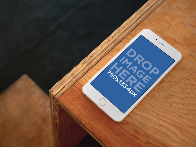 Mockup Template of iPhone 6 On Top Of Wooden Desk