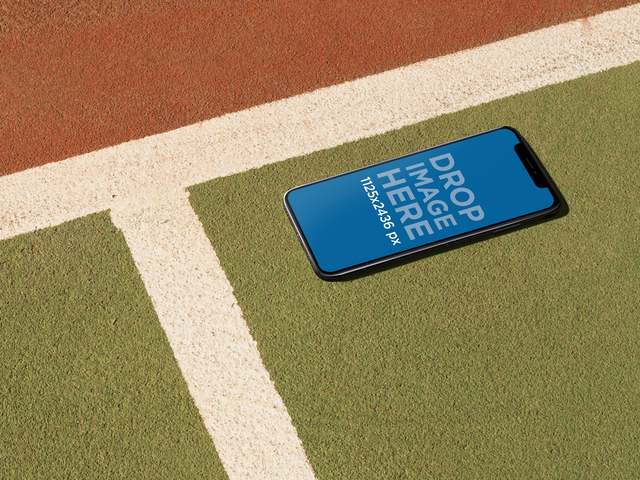 Mockup of an iPhone X Lying on a Tennis Court a17620