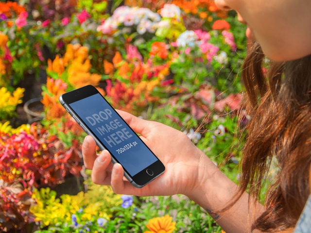 Product Mockup, iPhone 6 at a Flower Field Placeit Stage Image