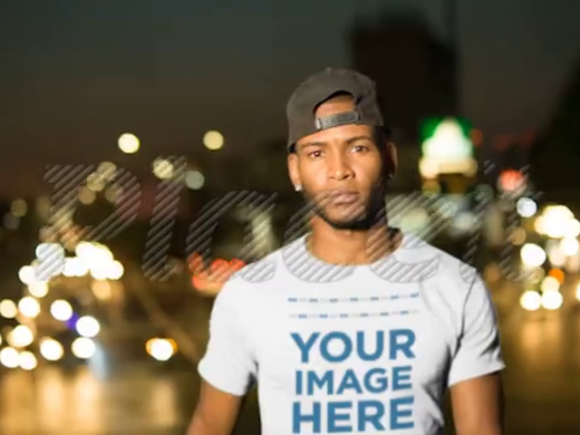 Handsome Man Wearing a T-Shirt Video Mockup in the City at Night a13507