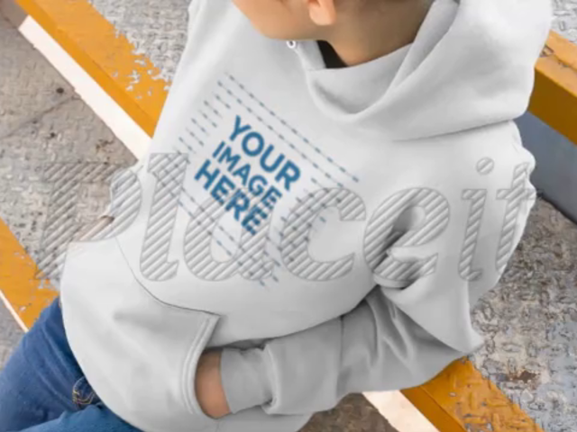 Girl Sitting On Industrial Stairs Wearing A Pullover Hoodie Video Mockup a13192