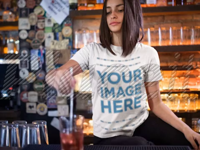 Trendy Girl Stirring a Drink at a Bar Wearing a T-Shirt Mockup Cinemagraph a13400