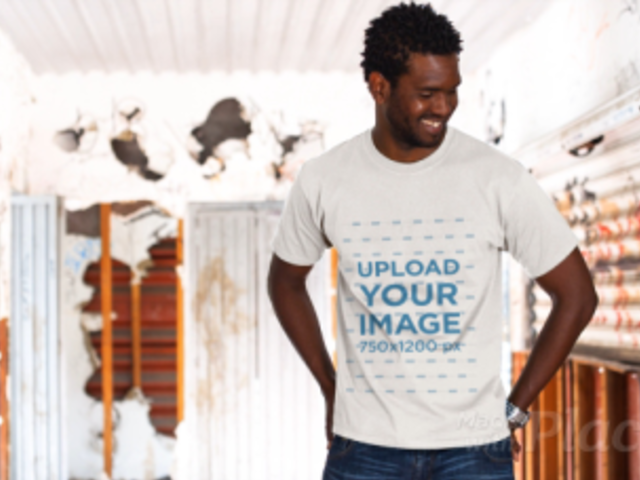 Handsome Black Man Wearing a Round Neck Tee Video Mockup in an Old Train Wagon a12781