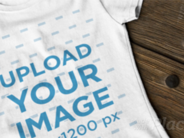 Woman's Round Neck T-Shirt Video Mockup on a Wooden Table a12346