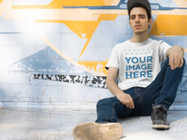 Skater Guy Sitting at the Skate Park Wearing a Round Neck Tee Video Mockup a12861