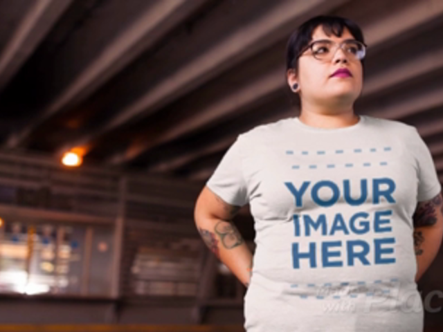 Young Woman with Glasses Out in the City Wearing a Plus Size Tshirt Video Mockup a12650