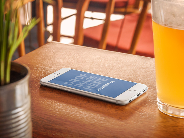 Product Mockup,iPhone 6 on Wooden Table next to a Beer Placeit Stage Image