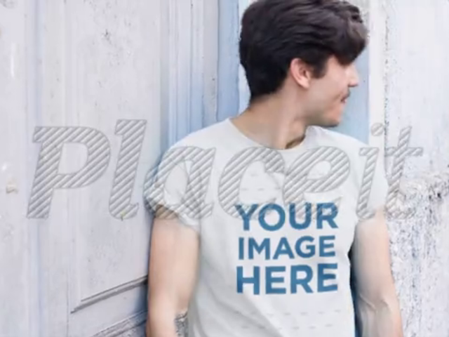 Hipster Young Man With Mustache Wearing a T-Shirt Video Outdoors a13467