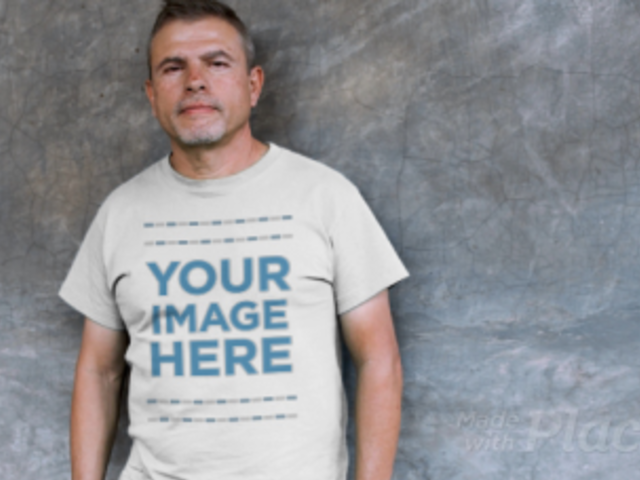 Video of a Middle Aged Hispanic Leaning Against a Black Wall Wearing a T-Shirt Mockup a12746