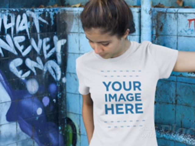 Smiling Young Woman at a Skate Park Wearing a Tshirt Video Mockup a12859