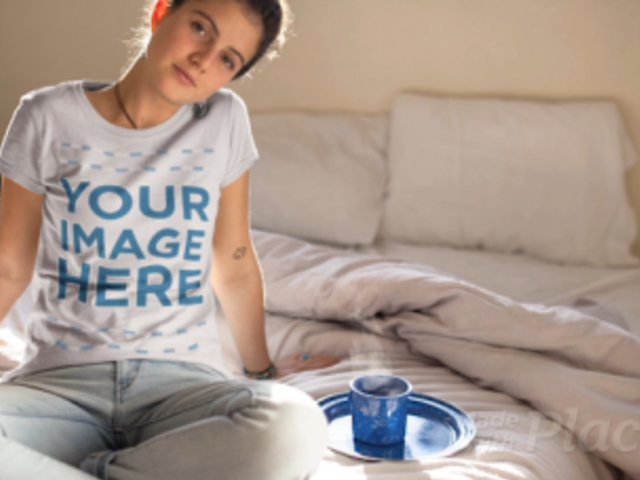 Happy Girl Sitting in Bed Drinking a Tea Wearing a T-Shirt Cinemagraph a13320