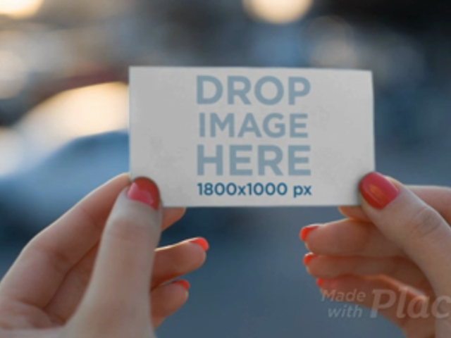 Business Card Video Mockup Being Held By A Girl a13917