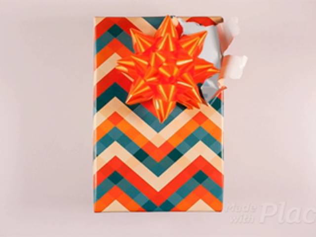 Book Gift Unwrapping Itself Standing on a Pink Environment in Stop Motion a13682