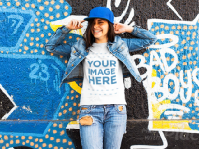 Young Trendy Girl Wearing a Hat and  a Tshirt Stop Motion with Denim Jacket Near a Graffiti Wall a13365