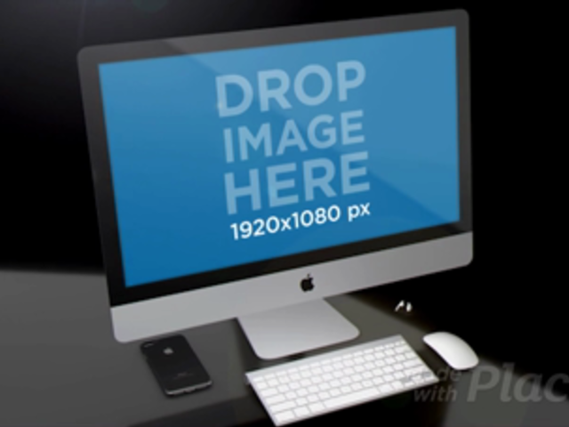 Black Room with a Black iPhone Earpods and an iMac Mockup Video a15826b