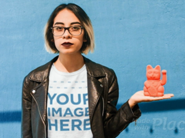 Young Girl with a  Leather Jacket Wearing a Tshirt Cinemagraph Holding a Manekineko a13606