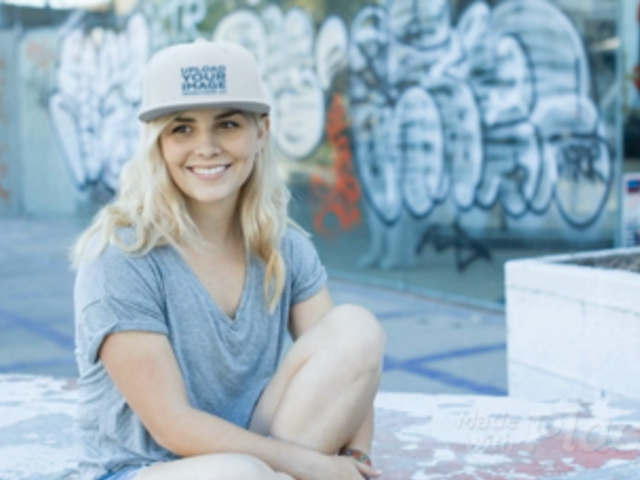 Blonde Girl Wearing a Snapback Hat Video while at a Skating Park a14137