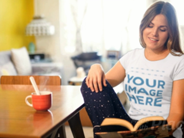 Girl Having a Coffee While Wearing a T-Shirt Cinemagraph and Reading a Book a13478
