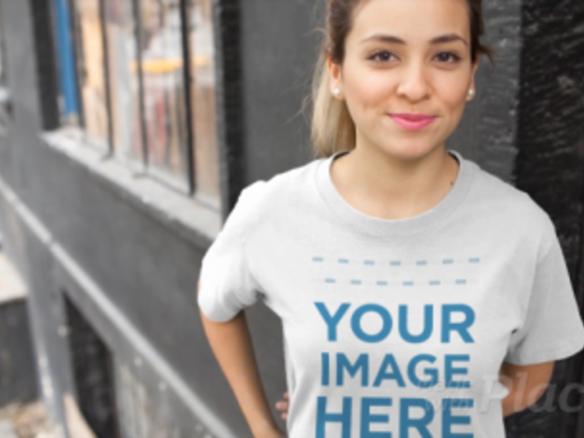 Smiling Girl Wearing a T-Shirt Video Mockup at a Building Facade Entrance a13048