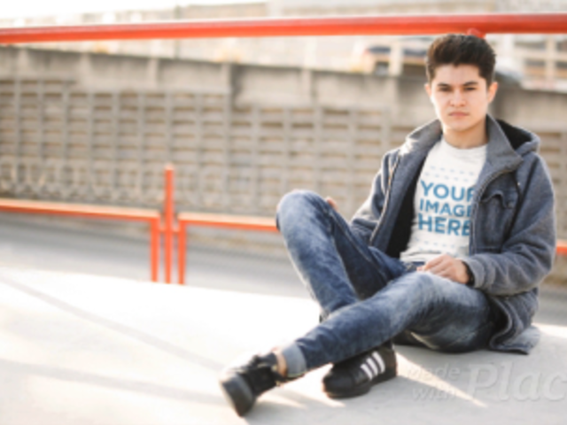 Young White Man Sitting Down in an Urban Environment Wearing a TShirt Cinemagraph a13496