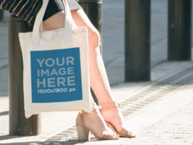 White Pretty Girl Carrying A Tote Bag While At Downtown Mockup Video a13914b