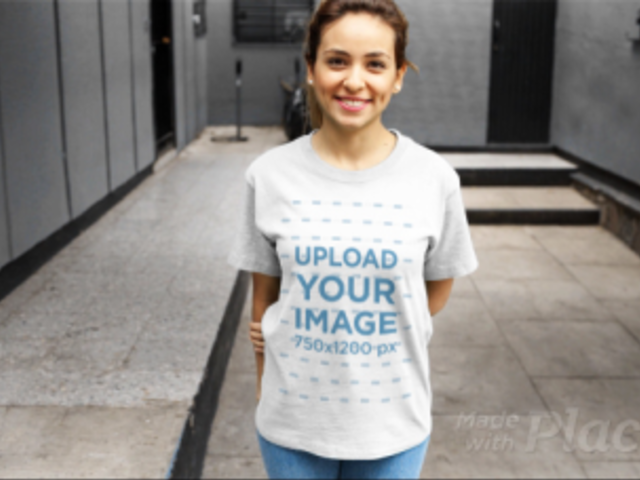 Young Woman Wearing a Round Neck Tee Video Holding her Arm a13049