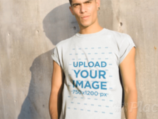 Man Wearing a Round Neck Tee Video Against a Concrete Wall a13494