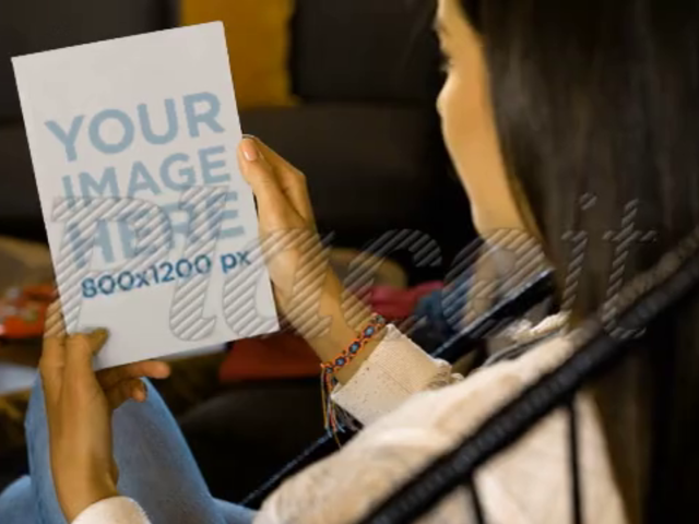 Video Of A Girl Holding A Flyer On Her Hands While Sitting On An Acapulco Chair Mockup a14009b