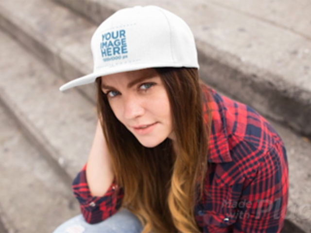Stop Motion Of A Young White Woman Wearing A Hat While Sitting Down In Concrete Stairways Mockup a13703b