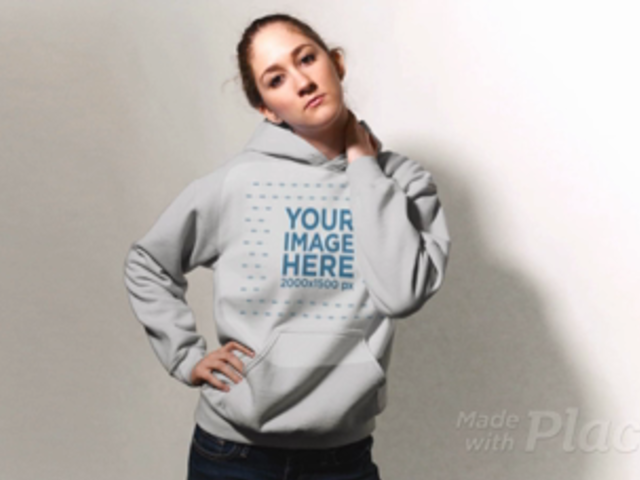 Blonde Girl Wearing A Pullover Hoodie in Stop Motion Against a White Background a13304
