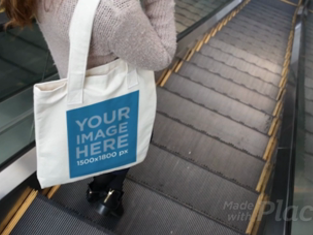 Girl Taking an Escalator While Holding a Tote Bag Video a13768