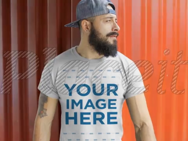 Dude with a Snapback Hat Wearing a T-Shirt Video Mockup in a Shipyard a12264