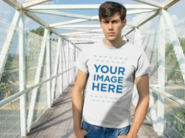 Young White Guy Standing on a Bridge Wearing a Tshirt Video a13012
