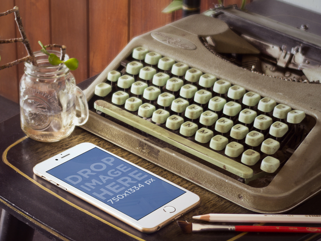 Mockup of Gold iPhone 6 Next to Vintage Typewriter Placeit Stage Image