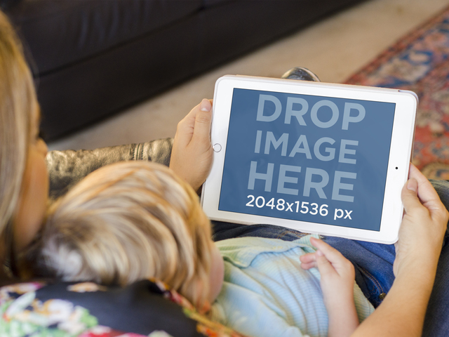 iPad Mockup of Mom and Baby Using White iPad in Sofa Placeit Stage Image