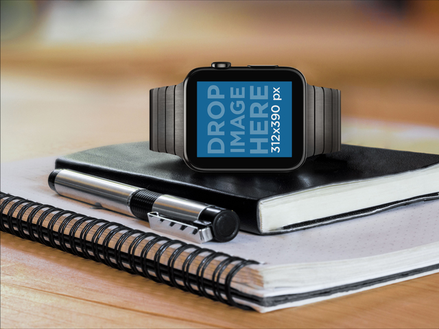 Black Apple Watch Over a Moleskine Mockup Template Placeit Stage Image