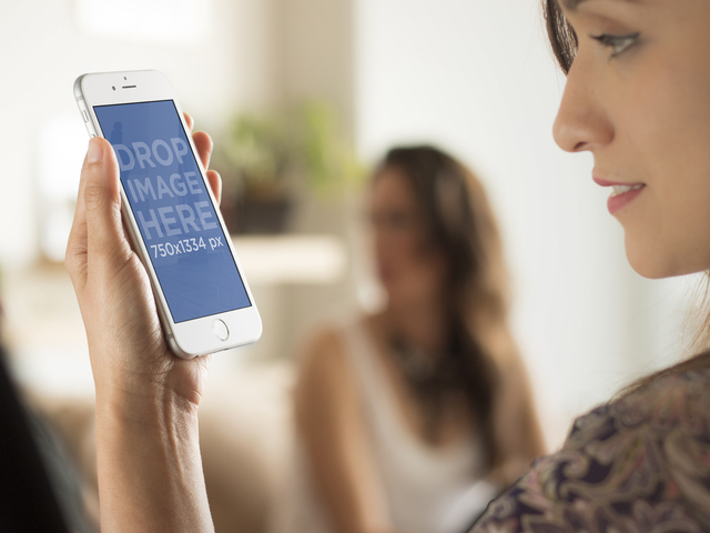 Mockup Template of Woman Using iPhone 6 at Social Event