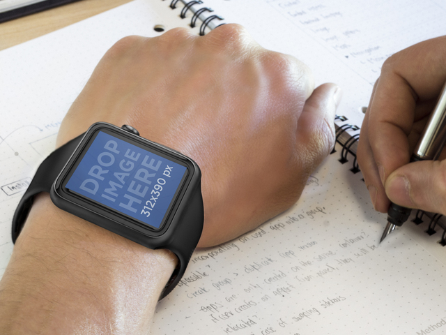 Mockup of Man Using Black Apple Watch While Taking Notes