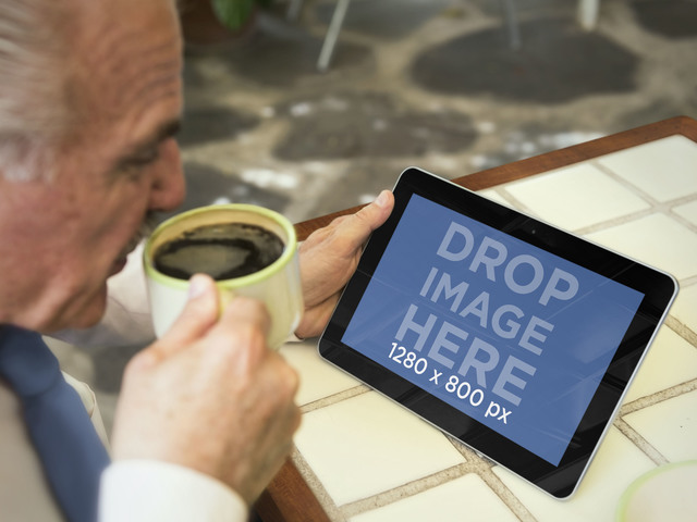 Gentleman Using Android Tablet While Drinking Coffee Mockup