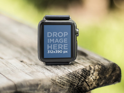 Black Apple Watch on a Wooden Picnic Table At The Park Mockup