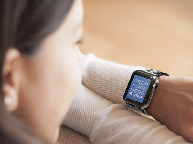 Woman Resting on Sofa Wearing a Black Apple Watch Mockup